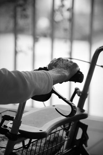 senior citizen's hand rests on a rollator by hand Old Senior citizen Rollator age Retirement To hold on holds Door handle Break reflection old age pension