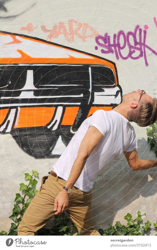 Human being Youth (Young adults) Young man Adults Graffiti Wall (building) Environment Art Wall (barrier) Orange Contentment Fear Car Masculine Transport