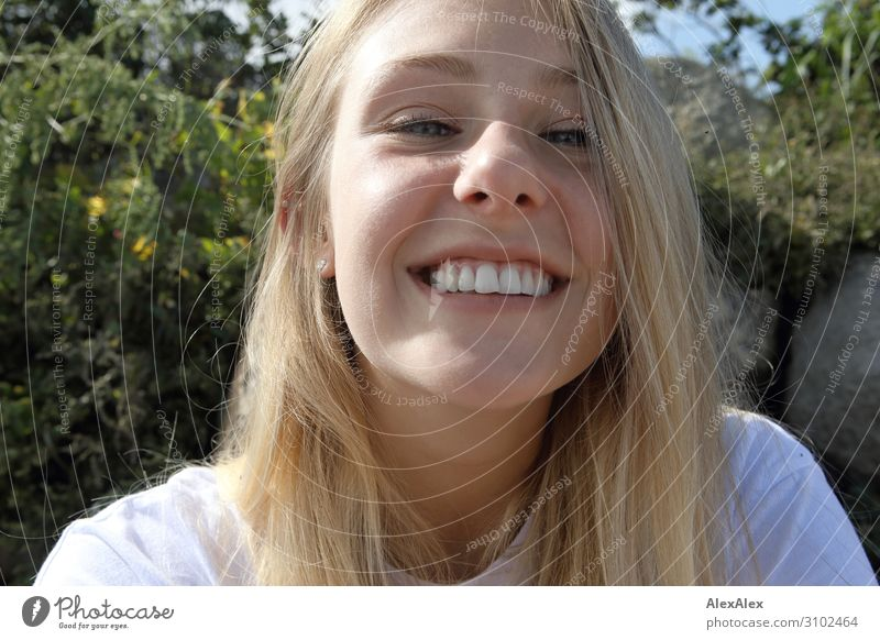 Very close portrait of a young blonde woman smiling cheekily into the camera Lifestyle Joy pretty Wellness Summer Summer vacation Sunbathing Young woman
