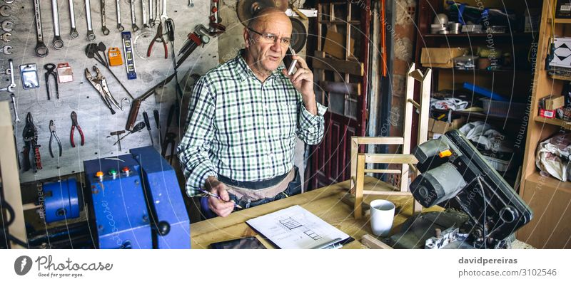 Carpenter in his workshop Chair Craft (trade) Business To talk Internet Human being Man Adults Wood Old Authentic carpentry mobile senior Custom-made Workbench