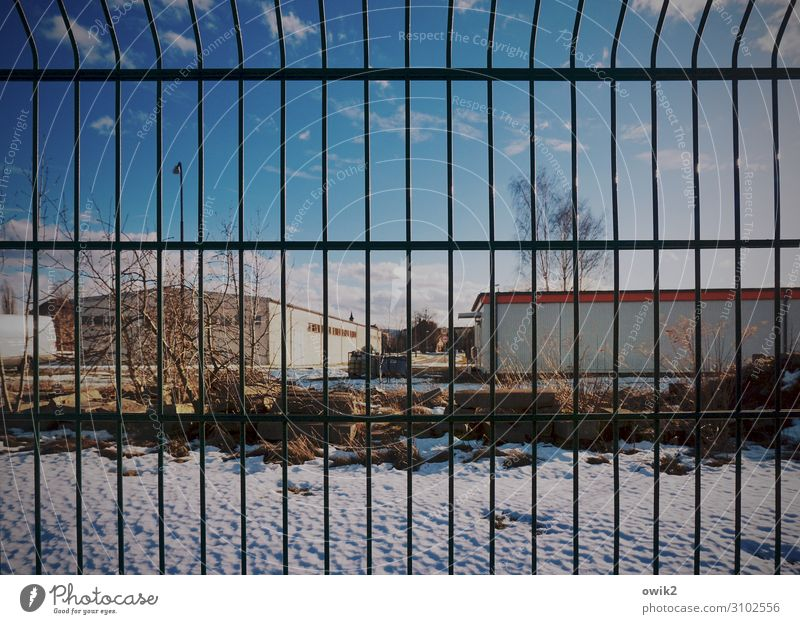 No access Sky only Clouds Winter Snow Tree Bushes Building Hall Warehouse Grating lattice fence Fence Metalware Barrier Border Boundary Firm Dismissive