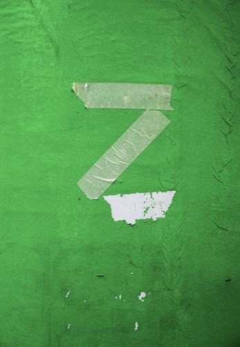 too late Z Capital letter Advertising column Paper Remainder Characters Old Simple Trashy Gloomy Green Adhesive tape Ravages of time Broken Colour photo