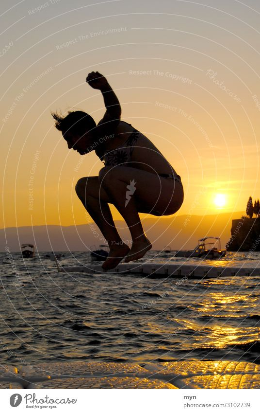 Silhouette of woman before sunset jumping into the water Jump Water Lake bathing fun bathe Swimming & Bathing Summer Sun Sunset Joie de vivre (Vitality)
