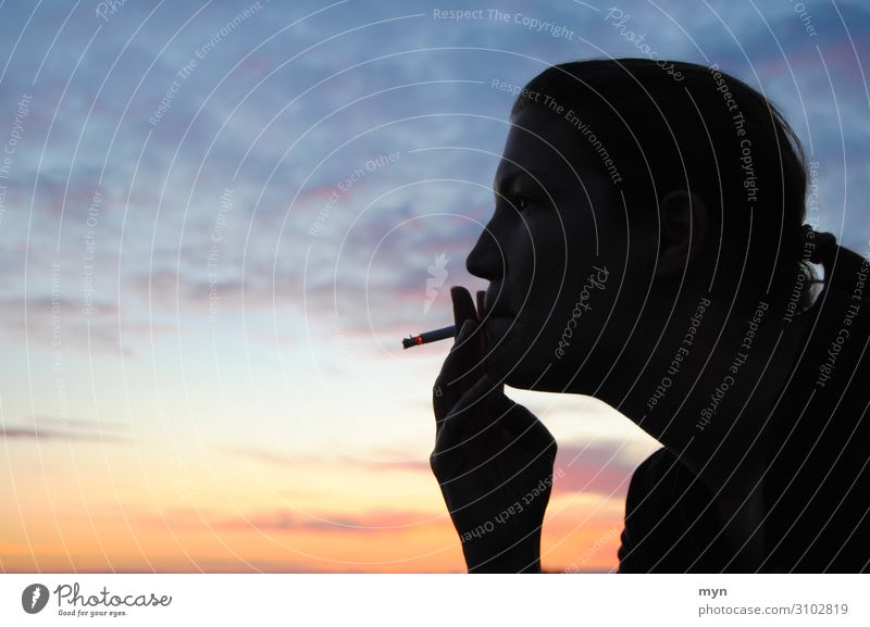 Silhouette of a smoking woman before sunset Smoking Sky Profile Cigarette Head Clouds Youth (Young adults) Orange Blue Adults Mouth Colour photo Twilight Sunset