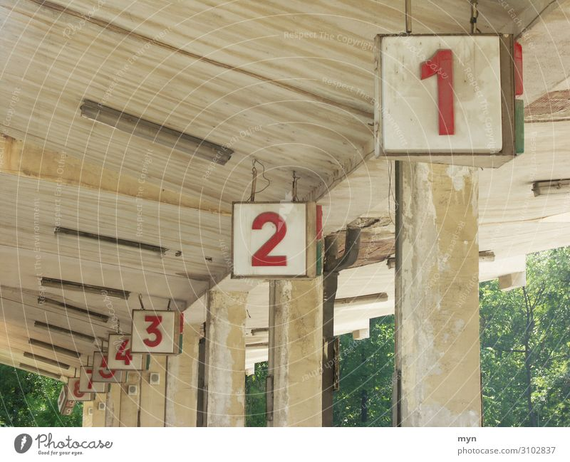 Platform numbers at bus station Numbers Numbers and numbers Digits and numbers Signs and labeling Concrete Colour photo Wall (building) Deserted Gray Old Facade