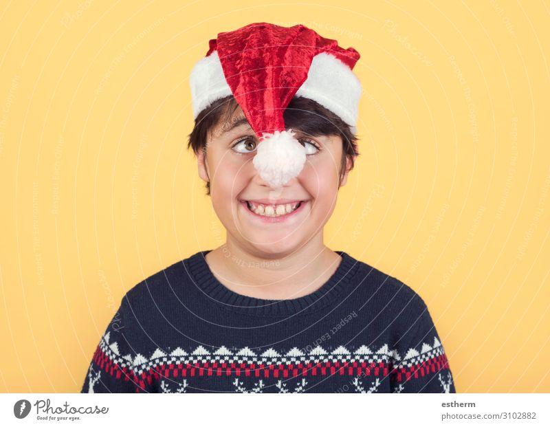 funny Child Wearing Christmas Santa Claus Hat Human being Christmas & Advent White Red Joy Winter Funny Emotions Laughter Feasts & Celebrations Contentment