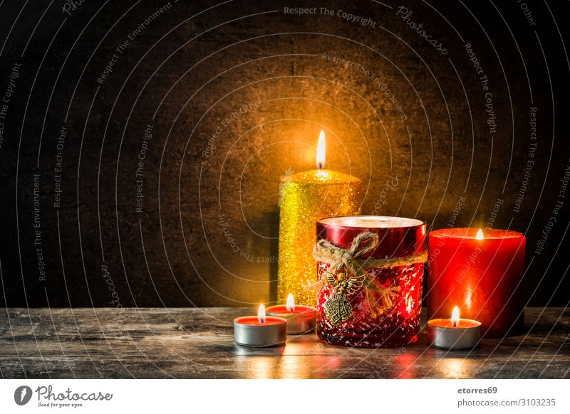Christmas candles on wooden table. Dim light. Christmas & Advent Candle Light Fire Wood Red Ornament background Festive Lighting Illumination