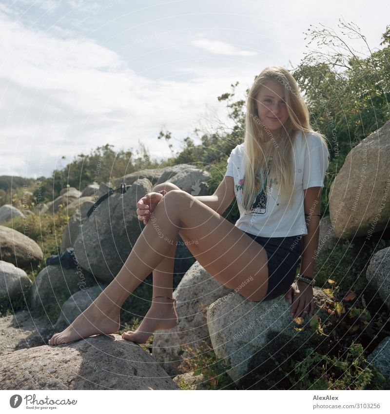 Portrait of a young woman on a rock dune Style Joy Beautiful Life Well-being Summer Summer vacation Beach Young woman Youth (Young adults) Legs 18 - 30 years