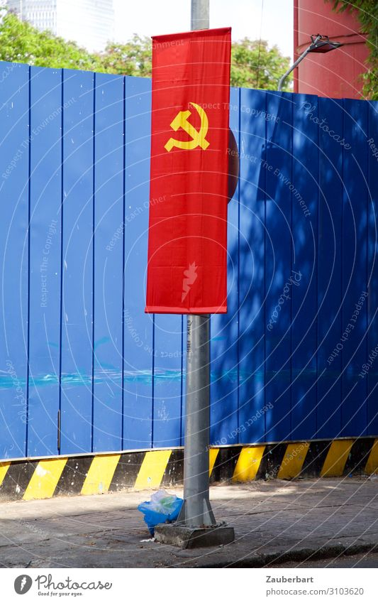 hammer and sickle on red and blue Saigon Vietnam Wall (barrier) Wall (building) Flag Flagpole Sign Sharp-edged Blue Red Honor Solidarity Stupid Force Precision