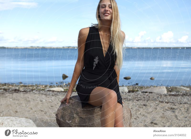Young woman in a black dress at the Baltic Sea Style Joy Beautiful Well-being Summer Summer vacation Sun Sunbathing Beach Ocean Youth (Young adults)
