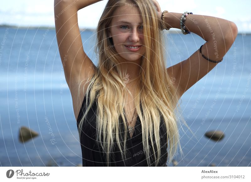 Portrait of a young blonde woman at the sea Joy already Summer Summer vacation Beach Ocean Young woman Youth (Young adults) Model 18 - 30 years Adults Landscape