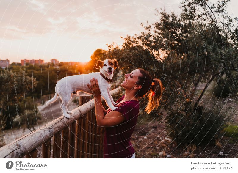 young woman and her dog watching sunset in a park Lifestyle Joy Happy Beautiful Leisure and hobbies Summer Sun Feminine Young woman Youth (Young adults) Woman