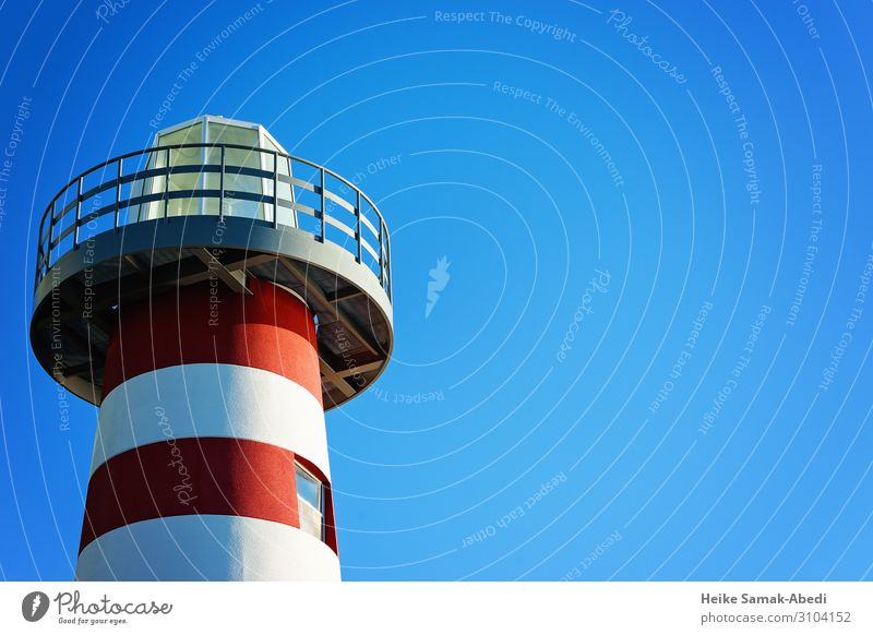 Section of a lighthouse Sky Tower Lighthouse Manmade structures Maritime Blue Red White Nautical Navigation Isolated Image Colour photo Copy Space right