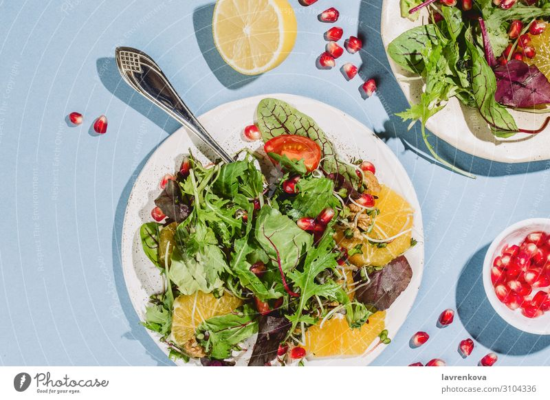 Flatlay of two citrus salad plates Appetizer Rucola cherry tomatoes Lemon Citrus fruits Cooking Delicious Diet Dinner flat flatlay Food Healthy Eating