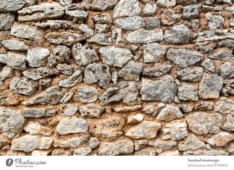 A texture of stones, also suitable as a background Design Nature Earth Wall (barrier) Wall (building) Retro aged aging ancient antique architecture