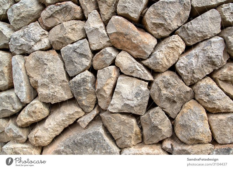 A texture of stones, also suitable as a background Design Nature Wall (barrier) Wall (building) Old aged aging ancient antique architecture Background picture