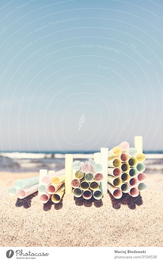 Stacks of plastic straws on a beach. Lifestyle Beach Ocean Industry Trade Environment Nature Sand Sky Tube Plastic Environmental pollution Change water litter