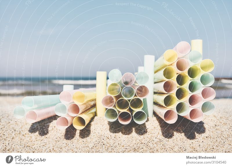 Stacks of plastic straws on a beach. Beach Ocean Industry Environment Nature Sand Sky Tube Plastic Tourism Environmental pollution Environmental protection