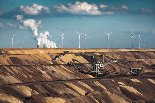 greed for profit Energy industry Renewable energy Wind energy plant Coal power station Earth Sky Clouds Climate change Authentic Threat Gloomy Blue Brown Gray