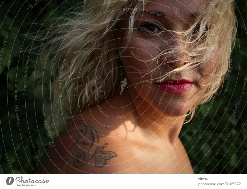 Mary Feminine Woman Adults 1 Human being Summer Beautiful weather Wind Park Tattoo Blonde Long-haired Curl Observe Looking Wait Wild Emotions Passion Trust