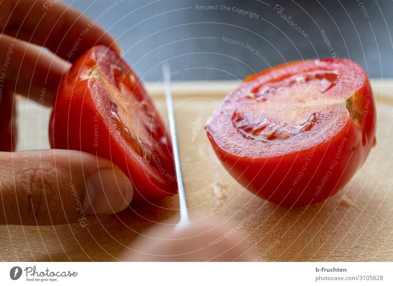 cut tomato Food Vegetable Lettuce Salad Nutrition Organic produce Vegetarian diet Knives Table Kitchen Workplace Fingers To hold on Fresh Healthy Half Division