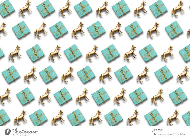 gift box and gold horse pattern composition. holiday background Christmas & Advent Blue Happy Feasts & Celebrations Copy Space Above Design Decoration