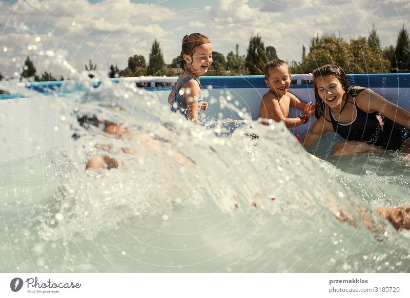 Children splashing in a pool Lifestyle Joy Happy Relaxation Swimming pool Playing Vacation & Travel Summer Summer vacation Human being Girl Boy (child)