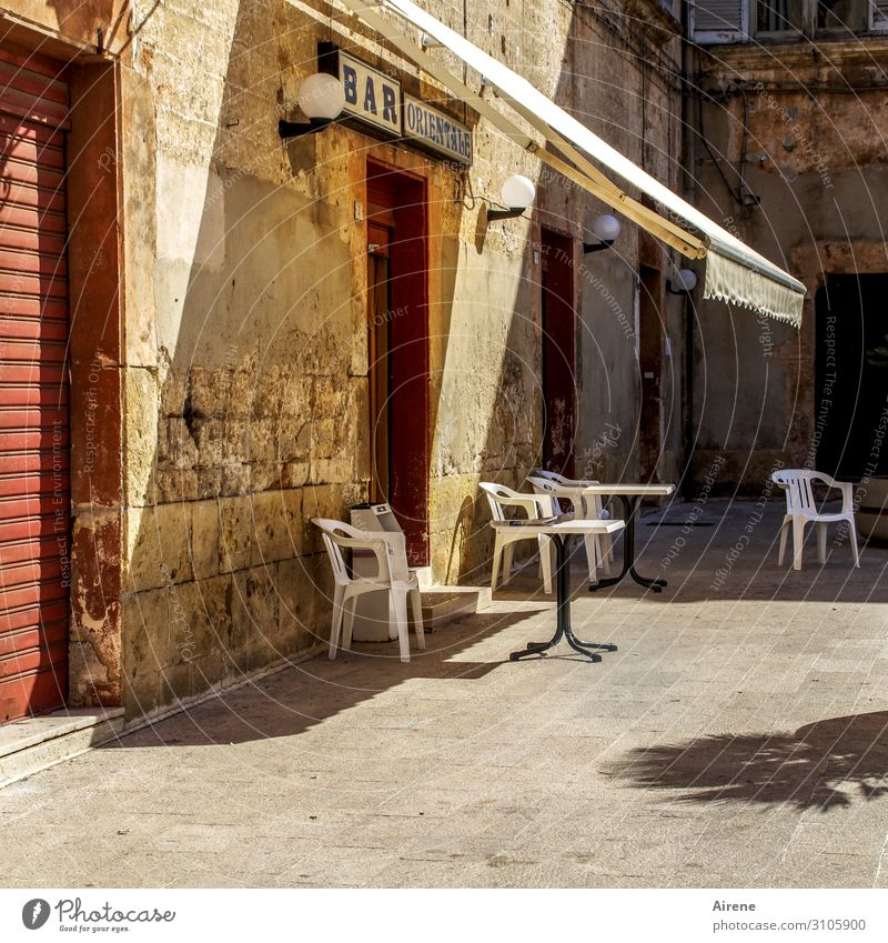 siesta Summer Beautiful weather Apulia Village Small Town Deserted Marketplace Facade Rolling door Sit Wait Simple Cliche Yellow Red Hospitality Calm Loneliness