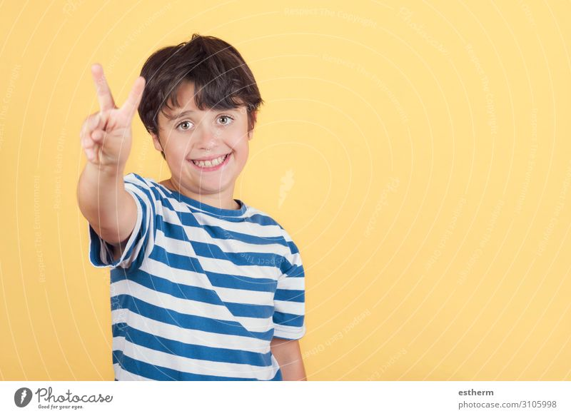 child smiling doing victory sign.Number two Joy Happy Success Human being Masculine Boy (child) Infancy Hand Fingers 1 8 - 13 years Child Digits and numbers