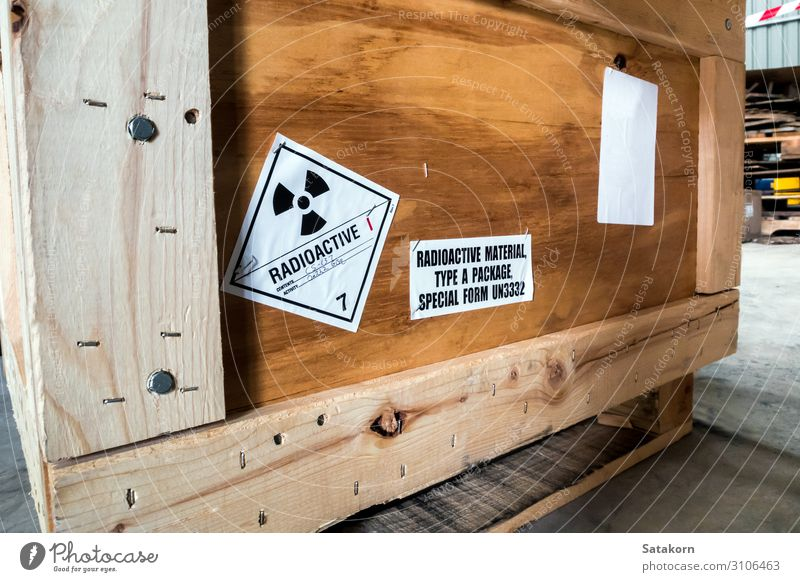 Radiation label beside the transport wooden box Industry Logistics Transport Package Strongbox Wood Sign Characters Signs and labeling Signage Warning sign
