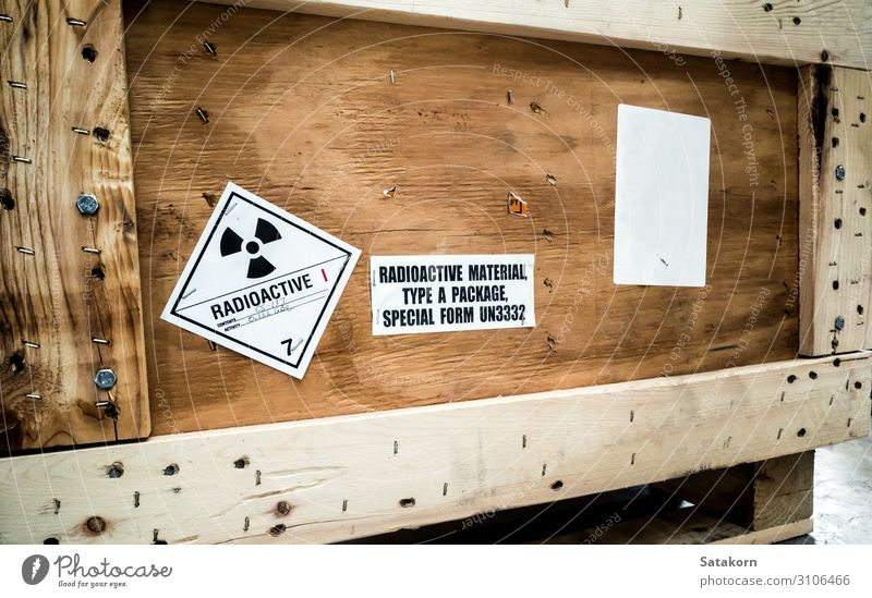 Radiation label beside the transport wooden box Industry Logistics Nuclear Power Plant Transport Package Strongbox Wood Sign Signs and labeling Signage