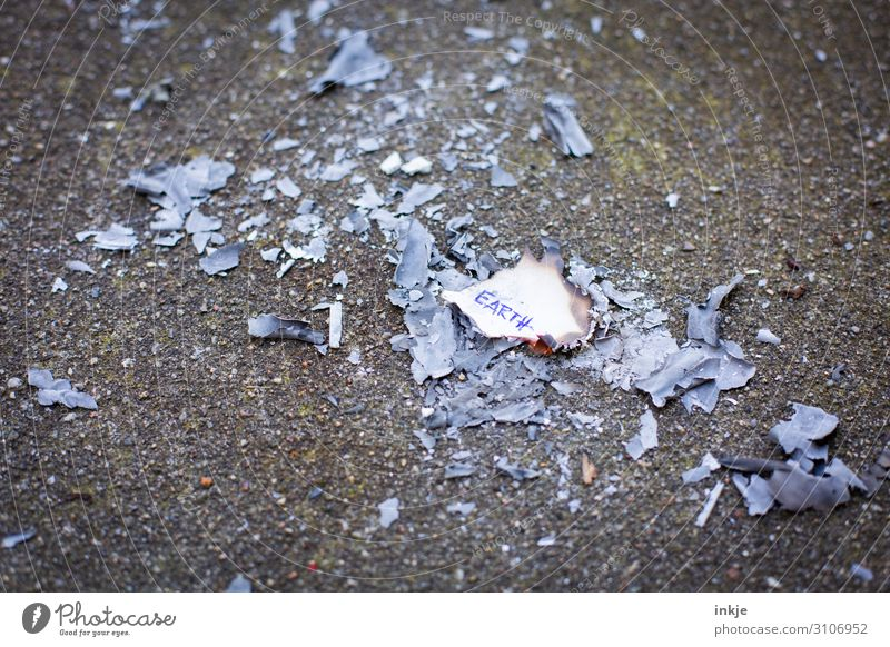 Burnt out Deserted Ashes Piece of paper Asphalt Characters Hot Remainder Earth Polluter Ecological disaster Environmental damage Environmental protection