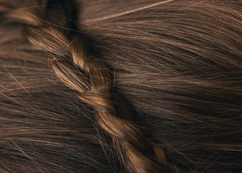 Close-up brown hair with braided hair Beautiful Personal hygiene Hair and hairstyles Head Brunette Braids Esthetic Colour photo Interior shot Deserted