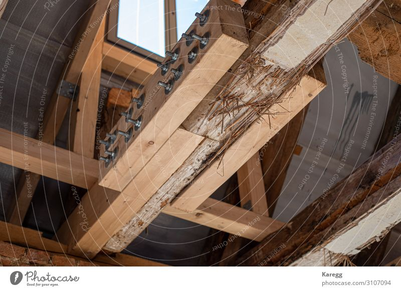 in laborious work an old house is restored Technology House (Residential Structure) Manmade structures Roof Monument Hat Old Dry Town Brown wooden Vintage