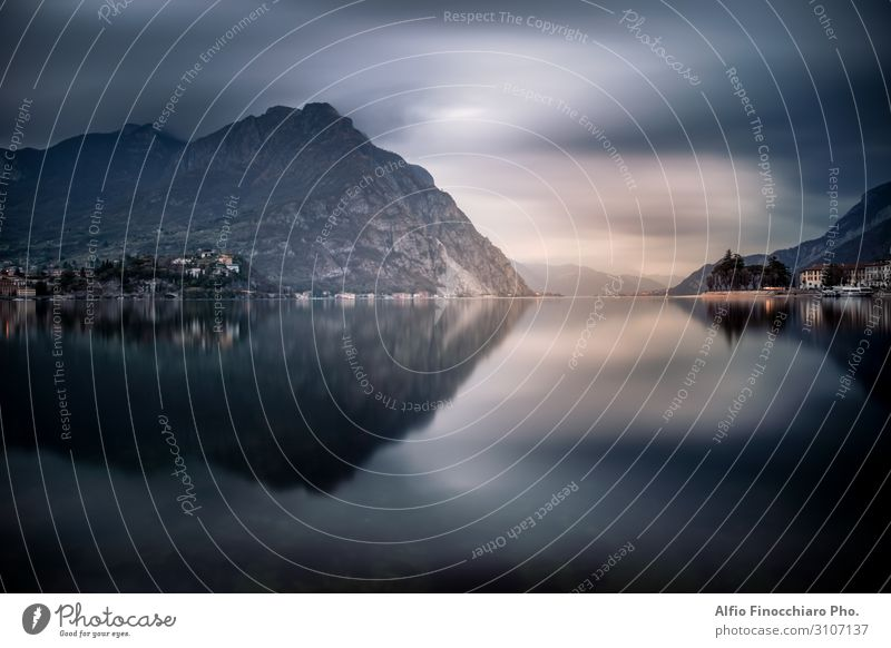 The mountains around Lecco reflected on the lake Vacation & Travel Tourism Winter Mountain Culture Environment Nature Landscape Sky Clouds Fog Coast Lakeside