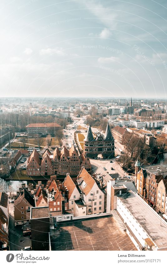 Lübeck from bird's eye view Northern Germany Town orange-teel Wide angle Sky Horizon Bird's-eye view houses Tower spires orangeteel orange and teel holstentor