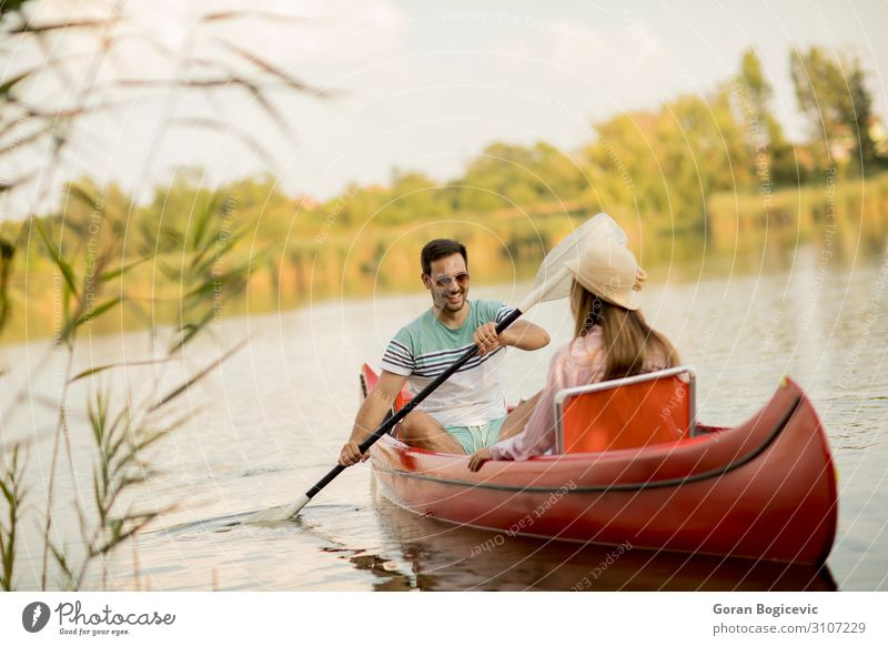 Loving couple rowing on the lake Lifestyle Joy Happy Relaxation Leisure and hobbies Vacation & Travel Tourism Summer Sports Human being Woman Adults Man Couple