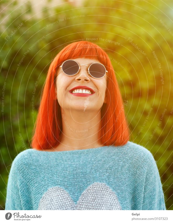 Red haired woman looking up in a park Lifestyle Style Joy Happy Beautiful Relaxation Leisure and hobbies Vacation & Travel Human being Woman Adults Fashion