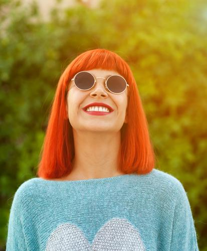 Red haired woman looking up in a park Woman Human being Vacation & Travel Blue Beautiful White Relaxation Joy Lifestyle Adults Happy Style Fashion