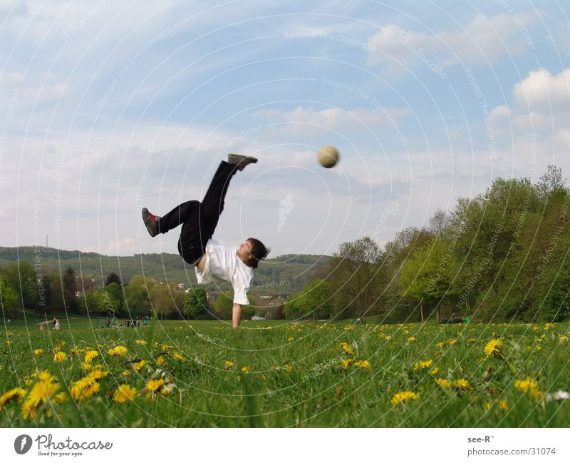 kick it Hand Withdraw Meadow Extreme Colorless Sports Soccer Breakdance Ball Feet in midair Sky Pain