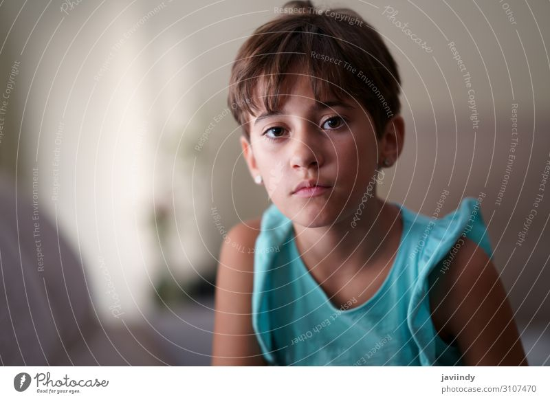 Little girl, eight years old, looking at camera seriously. Woman Child Human being Beautiful White Loneliness Girl Face Lifestyle Adults Sadness Feminine
