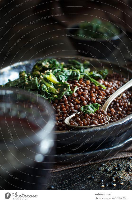 Black lentils and vegetables stew Vegetable Vegetarian diet Plate Spoon Dark Lentils legumes Beluga Spinach Vegan diet Copy Space food garnish healthy