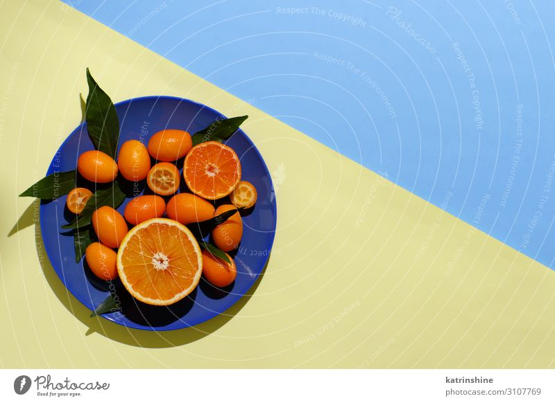 Citrus fruits on a yellow and blue background Fruit Nutrition Vegetarian diet Diet Plate Exotic Summer Group Leaf Fresh Modern Natural Juicy Blue Yellow Colour