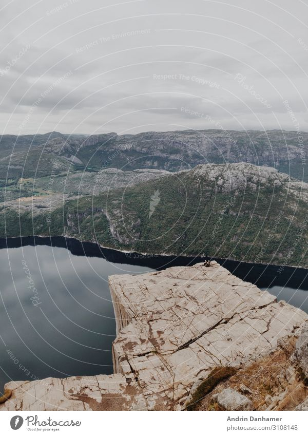 Preikestolen Norway in the morning Environment Nature Landscape Water Clouds Bad weather Rock Mountain Bay Fjord Stone To enjoy Hiking Blue Brown Gray Green