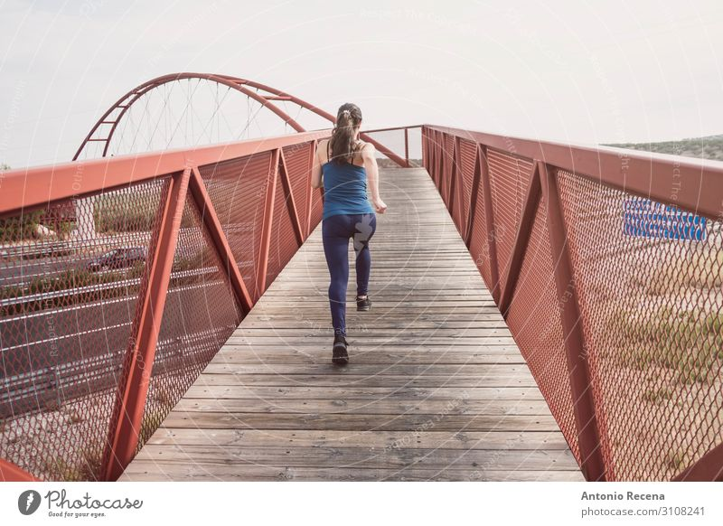mid adult woman running on a bridge Lifestyle Sports Woman Adults Bridge Architecture Pedestrian Highway Loneliness 30s mid adult person sprint level crossing