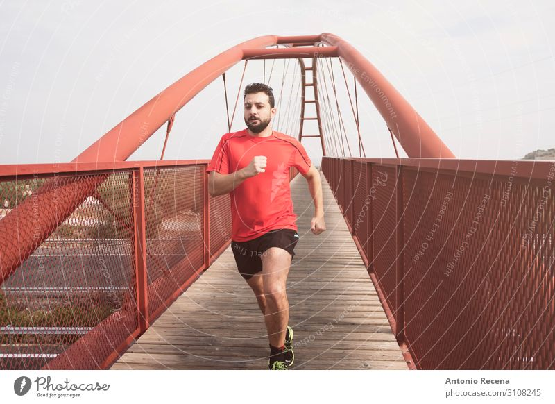 Bearded mid adult man running Lifestyle Sports Human being Man Adults Bridge Pedestrian Shirt Red Effort 30s mid adult person sprint level crossing bearded