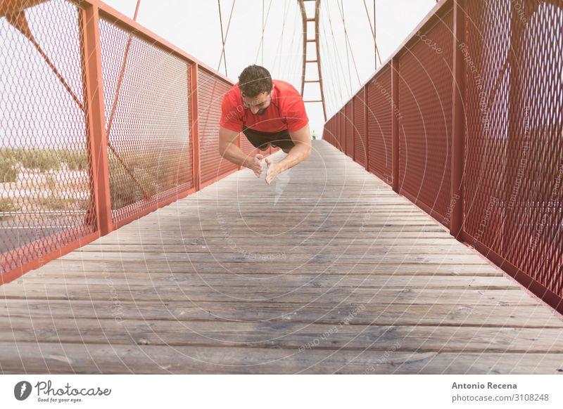man training push ups on a bridge Sports Human being Man Adults Bridge Pedestrian Beard Fitness Jump Muscular Red Effort Musculature 30s 40s real people candid