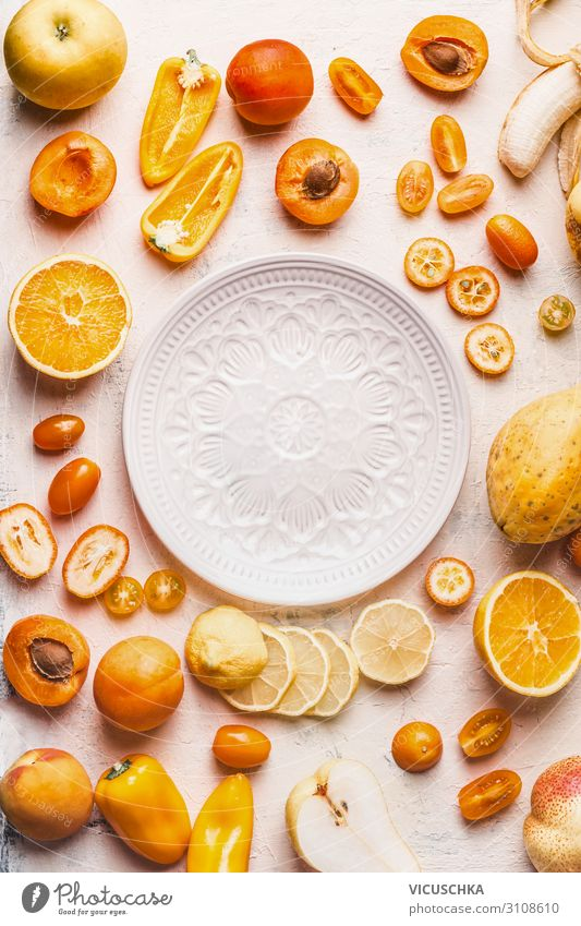 Yellow and orange fruit and vegetables around white plate Food Vegetable Fruit Orange Plate Style Design Healthy Eating Hip & trendy Papaya Background picture