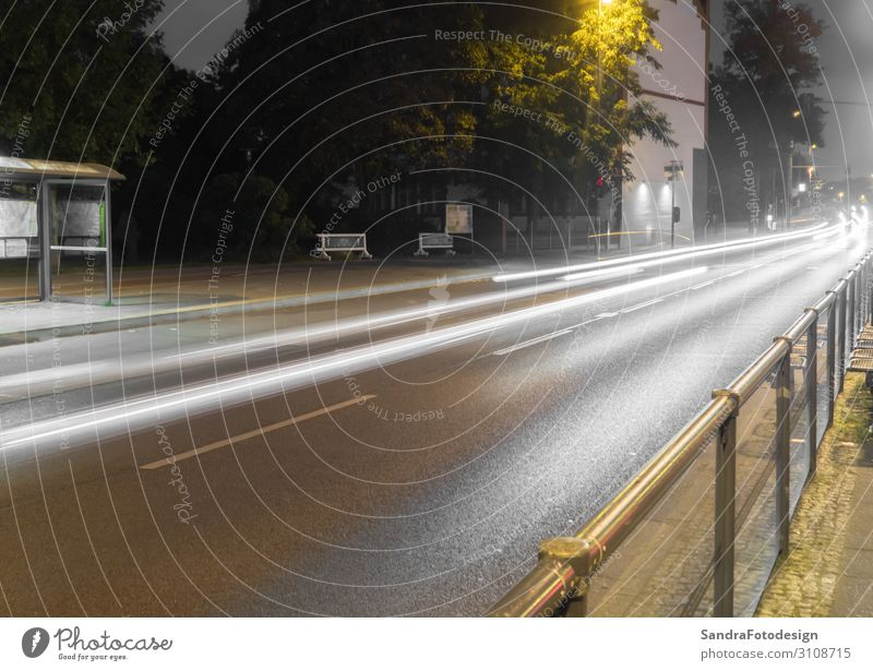 Road at night with light trails of cars Vacation & Travel Environment Rain Transport Road traffic Street Highway Car Driving Attentive Conscientiously motion