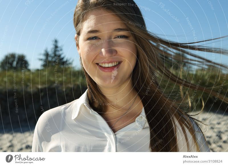 Portrait of a young woman in front of a dune Joy Beautiful Life Well-being Summer Summer vacation Sun Beach Beach dune Young woman Youth (Young adults) Face